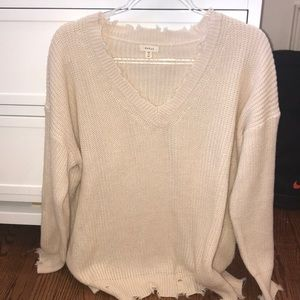 Debut women's v- neck distressed sweater